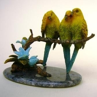 Budgerigars on Dumortierite