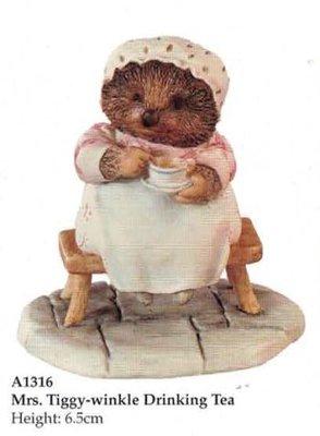Mrs Tiggy-Winkle drinking tea