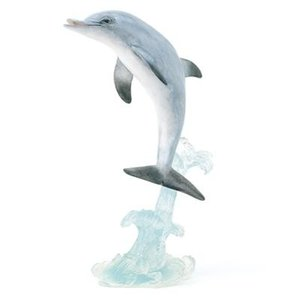 Dolphin dancing on a wave